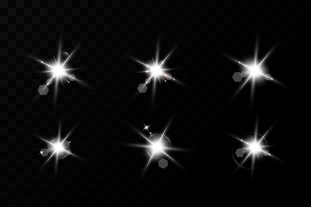 光の効果のセット。輝く星。まぶしい太陽。