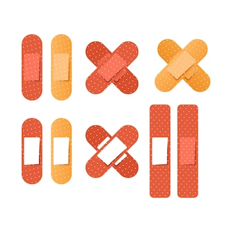 Набор медицинских пластырей разной формы, изолированные на белом фоне