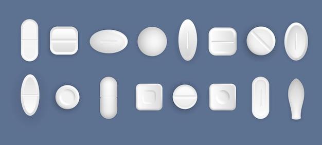 의료 흰색 알 약의 집합입니다. 스타일의 평평하고 볼록한 정제.