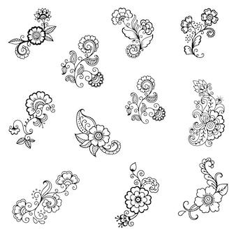 一時的な刺青の花と曼荼羅のセット。エスニックオリエンタル、インドスタイルの装飾。落書き飾り。