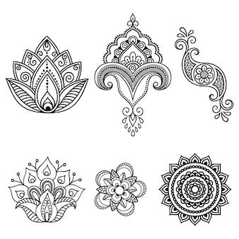 一時的な刺青の花柄とヘナの描画とタトゥーの曼荼羅のセット。エスニックオリエンタル、インドスタイルの装飾。落書き飾り。