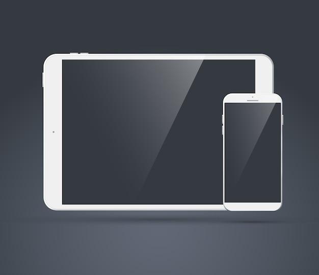 그들의 광택 디스플레이에 그림자가있는 어두운 회색의 현대 태블릿 및 휴대 전화 세트가 꺼져 있습니다.