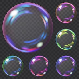 Набор разноцветных прозрачных мыльных пузырей с бликами. прозрачность только в векторном формате. может использоваться с любым фоном