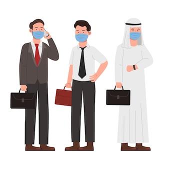マスクを身に着けている新しい通常のオフィスワーカーの実業家のセット