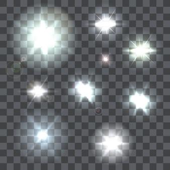 9つのレンズのセットフレアビームと透明な背景に点滅