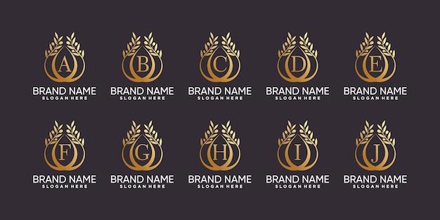 Набор оливковых деревьев логотип дизайн буквица от a до j с штриховой графикой и золотым цветом