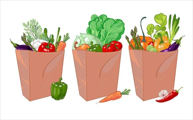 Набор бумажных пакетов, полных здоровых овощей.