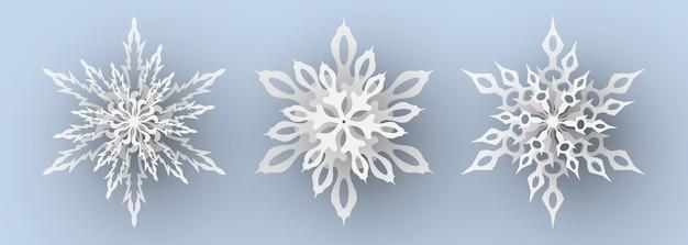 Набор снежинок вырезки из бумаги.