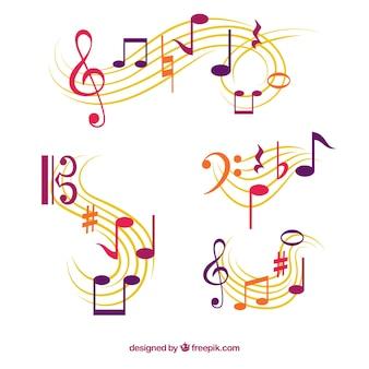 Набор пентаграмм с музыкальными нотами