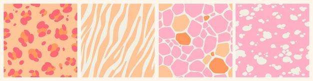 動物の肌の質感とピンクの抽象的なシームレスパターンのセットです。ヒョウ、キリン、シマウマ、ダルメシアンのスキンプリント。