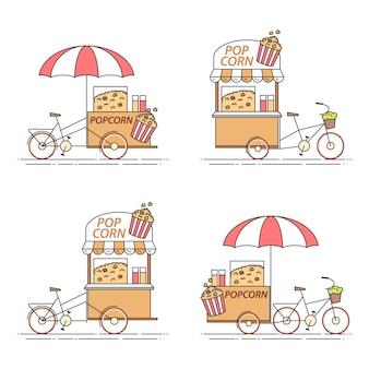 Набор поп-кукурузы велосипедов. различные тележки на колесах в плоской линии арт.