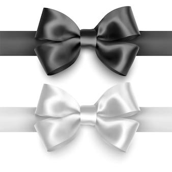 現実的な弓のセット白の背景に分離された黒と白の色のリボン