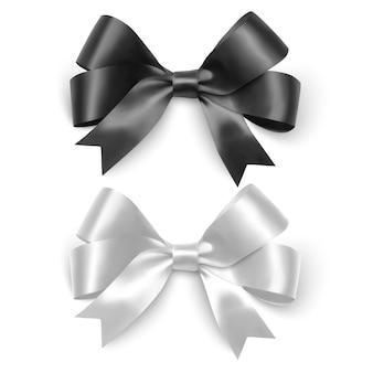 分離された黒と白の色の現実的な弓のリボンのセット