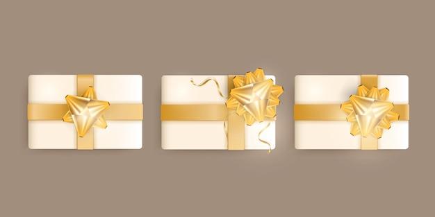 Набор реалистичных подарочных коробок цвета шампанского, золотых лент и банта. векторная иллюстрация.