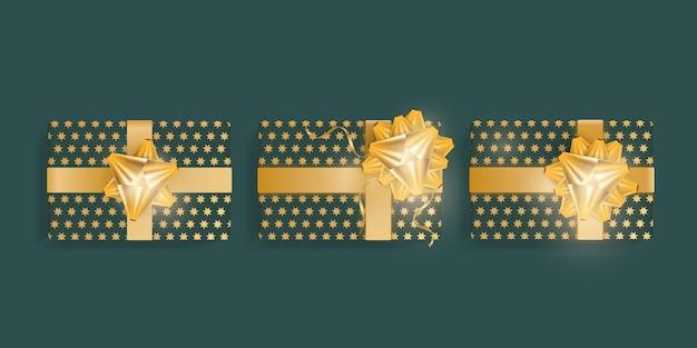 골드 스타, 골드 리본 및 활 현실적인 녹색 선물 상자 세트. 위에서 볼 수 있습니다. 벡터 일러스트 레이 션.