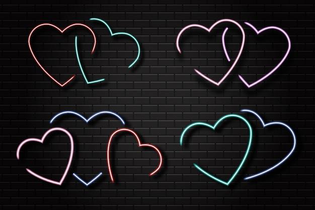 Набор реалистичных неоновых вывесок сердца на фоне стены.