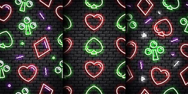 Набор реалистичных изолированных неоновых бесшовные модели карточного масти на бесшовной стене