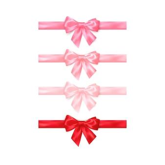Набор реалистичных блестящих красных и розовых бантов на белом фоне.