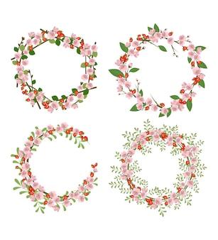 ローズヒップリースのセット。丸いフレーム、かわいいピンクの花と赤い果実。