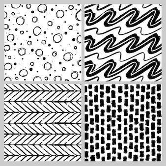 黒と白の落書きのシームレスなパターンのセット