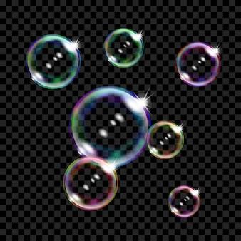 Набор из нескольких полупрозрачных цветных мыльных пузырей на прозрачном