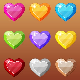 Набор формы сердца разных цветных драгоценных камней.