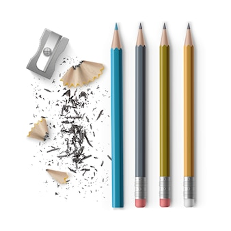 白い背景で隔離の削りくずとゴムとシャープナーとシャープな色とグラファイト鉛筆のセット