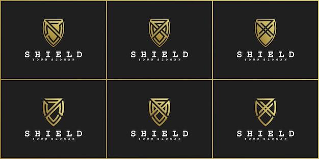 Набор шаблонов дизайна логотипа щита с концепцией золотых градиентных цветов для компании premium vekto