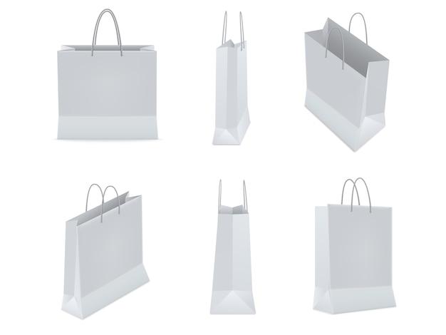 プラスチックまたは白い背景の上のハンドルを持つ紙からの買い物袋のセットです。図。