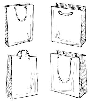 白い背景で隔離の買い物袋のセットです。スケッチスタイルのイラスト。