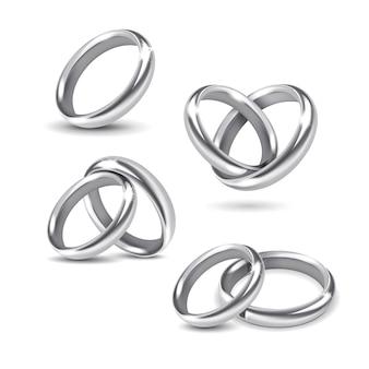 白い背景の上の銀の結婚指輪のセット