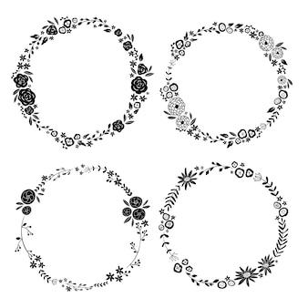 黒い色のシンプルなフラワーフレームのセット。手描きスタイル。