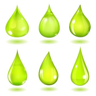 飽和緑色のさまざまな形の6つの不透明な滴のセット