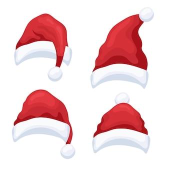 Набор маленьких красных рождественских шапок на белом фоне