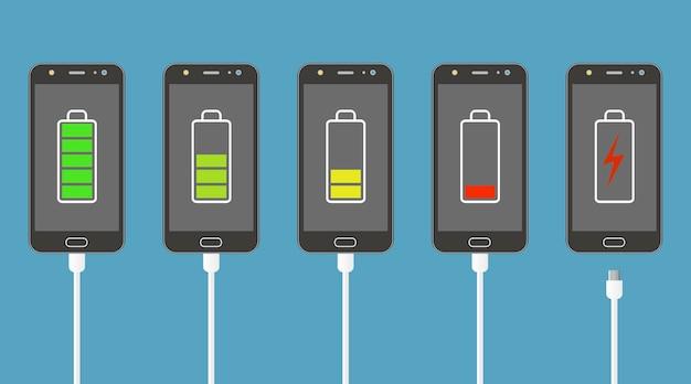 バッテリー充電レベルインジケーターと充電器接続を備えたスマートフォンのセット