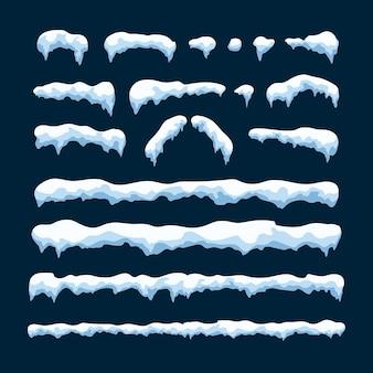 青い背景に分離されたスノーキャップのセットです。新年とクリスマスの装飾要素
