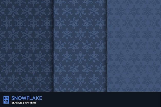 インディゴブルーの背景にスノーフレークシームレスパターンのセット