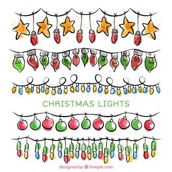 Набор струнных огней и рисованной рождественских элементов