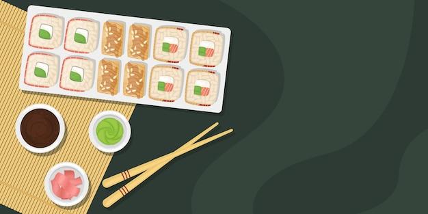 醤油、わさび、生姜を添えた木の板に寿司とロールのセット。日本食。