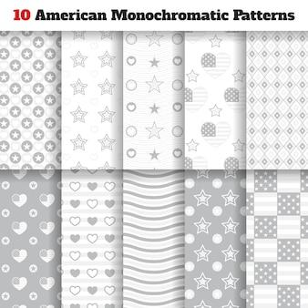 星、ストリップ、旗、ハートの10個の単色のアメリカのシームレスなパターンのセット