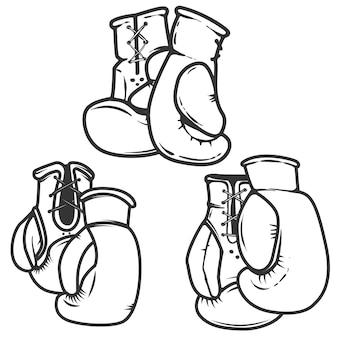 白い背景の上のボクシンググローブアイコンのセットです。ロゴ、ラベル、エンブレム、看板、ポスターの要素。図。