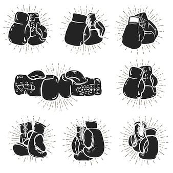 白い背景の上のボクシンググローブのセット。ロゴ、ラベル、エンブレム、記号、ポスターの要素。図