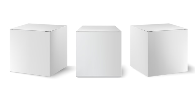 Набор из трех белых коробок, расположенных под разными углами. реалистично.