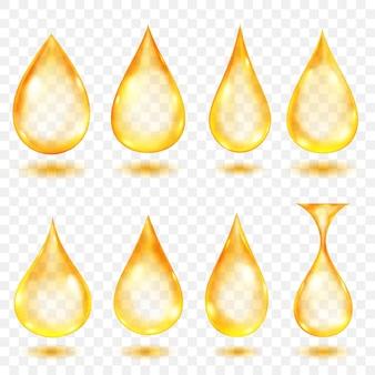 透明な背景に分離された、さまざまな形の黄色の半透明の水滴のセット。ベクトル形式のみの透明度