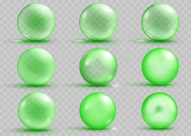 透明と不透明の緑の球体のセットで、透明に影とまぶしさがあります。