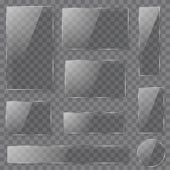 그림자와 함께 어두운 색상에 다른 모양의 투명 유리 접시 세트.