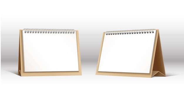 2つのスパイラルテーブルカレンダーのセット。灰色の背景に分離。