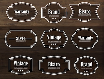 Set of vector vintage style frame labels on wood texture