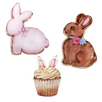 水彩のイースターのお菓子、ペストリーのセットです。ジンジャーブレッドのバニーと耳付きのカップケーキ。イースター春手描きイラスト