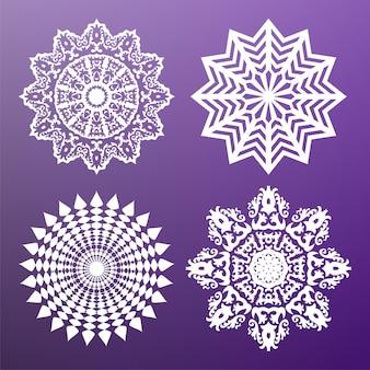 白い円形の抽象的なパターンのセットです。丸いベクトルの飾り。スノーフレーク。マンダラ。アラベスク。ベクトルイラスト。